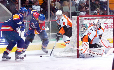 Marc-Andre Bourdon, Phantoms, and goalie Johan Backlund, Phantoms, defend their goal against Norfolk Admirals Justin Keller, left, and Radek Smolenak during their first hockey game of the new year Saturday evening. Photo Erica Miller 1/2/10 spt_Phantoms2_Sun