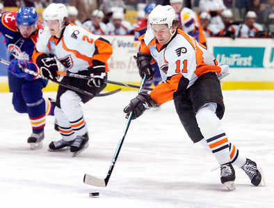 Jon Matsumoto, Phantoms, glides the puck down the rink during their first hockey game of the new year against the Norfolk Admirals Saturday evening. Photo Erica Miller 1/2/10 spt_Phantoms1_Sun