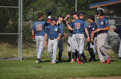 Southern Humboldt's Andrew Matyshock, far left, is congratulated by teammates on his way to the dugout after his third inning solo jack against Northern Humboldt on Thursday.