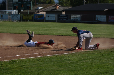 Northern Humboldt's XX slides safely back to first as Southern Humboldt's Chase Brodt tries to apply the tag in the second inning of Thursday's game.