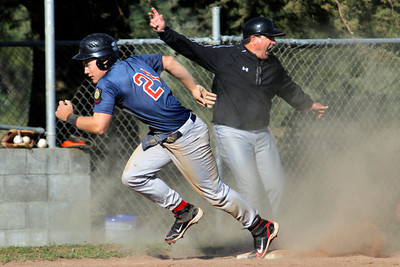 Josh Jackson/The Times-Standard  Southern Humboldt's #21 bolts from third base as the base coach makes the call to go home during Saturday's game in Fortuna