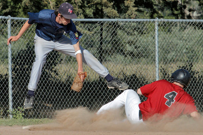 Josh Jackson/The Times-Standard  Northern Humboldt's #4 slides into third as Southern Humboldt's #25 lands for the tag during Saturday's game in Fortuna
