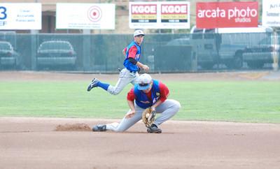 JosŽ Quezada/For the Times-Standard  #32 EL_DORADO shortstop makes a stop before turning a double play.   EL_DORADOvs Petaluma Leghorns 4 PM Championship game at Arcata Ball park.
