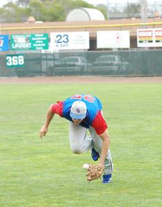 JosŽ Quezada/For the Times-Standard  #25 EL_DORADO left fielder makes a dramatic catch in early innings.  EL_DORADO vs Petaluma Leghorns 4 PM Championship game at Arcata Ball park.