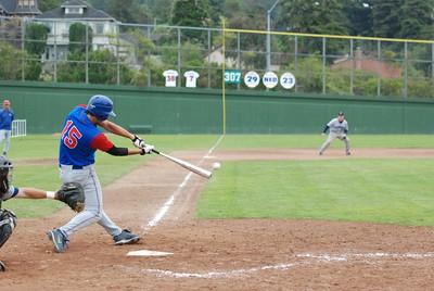 José Quezada/For the Times-Standard  #15 for EL_DORADO punches a hit between the gap of left and center fields.   EL_DORADO vs Petaluma Leghorns 4 PM Championship game at Arcata Ball park.