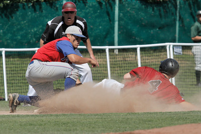 Josh Jackson/The Times-Standard  NoHum's #4 slides safe into third base during Wednesday's game in Arcata.