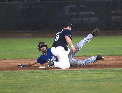 JosŽ Quezada/For the Times-Standard  Steelhead beats the tag to second base. Crabs manager contested the call to no avail.
