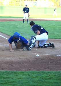 José Quezada/For the Times-Standard  Steelheads #9 scores on a passed ball to the Crabs catcher.