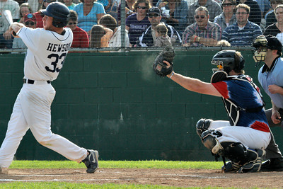 Josh Jackson/The Times-Standard  Dust pops off the Crabs' #33's glove as Nevada's #33 strikes during game one of Saturday's doubleheader in Arcata.