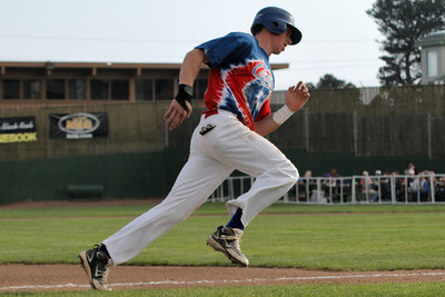 Josh Jackson/The Times-Standard  Crabs' #22 passes third base on his way to score during game one of Saturday's doubleheader in Arcata.