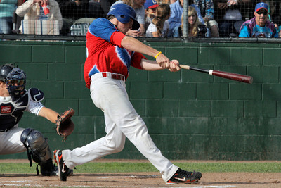Josh Jackson/The Times-Standard  Crabs' #25 connects to bring home #15 during game one of Saturday's doubleheader in Arcata.
