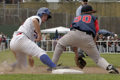 Josh Jackson/The Times-Standard  Crabs' #24 beats the throw to third during Sunday's game in Arcata.