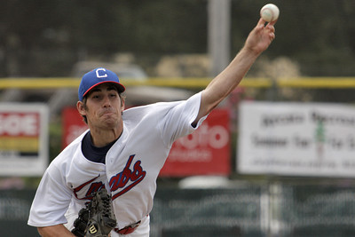 Josh Jackson/The Times-Standard  Crabs' #11 fires a pitch during Sunday's game in Arcata.
