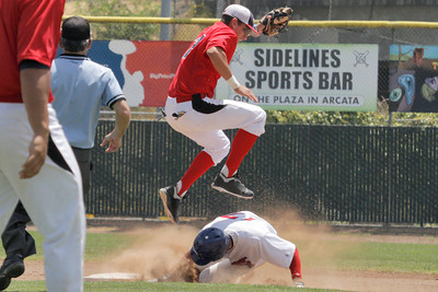 Josh Jackson/The Times-Standard  Crabs' #17 slides under a leaping Glory's #2 during Sunday's game in Arcata.