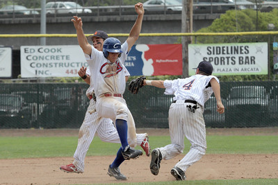 Josh Jackson/The Times-Standard  Crabs' #15 can't dodge the tag of Gnats' #4 as he gets caught in a pickle during Monday's game in Arcata.