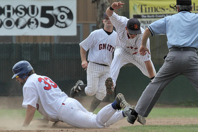 Josh Jackson/The Times-Standard  Crabs' #33 is out at second as Gnats' #18 leaps over him after the tag during Monday's game in Arcata.