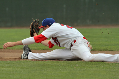Josh Jackson/The Times-Standard  Crabs' #25 goes for the full extension for the out attempt at first base during Monday's game in Arcata.