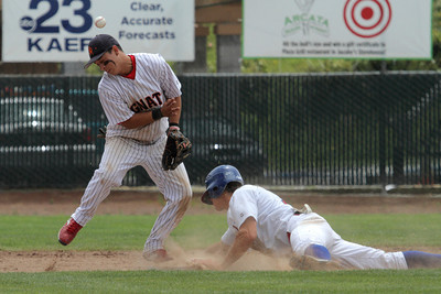 Josh Jackson/The Times-Standard  Crabs' #15 is safe at second base as Gnats #18 can't make the catch during Monday's game in Arcata.