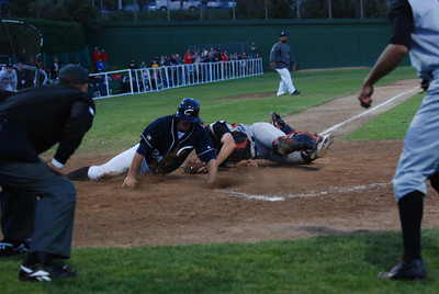 José Quezada/For the Times-Standard  A controversial call ended as an out as #24 slides into home after being hooked by the Redding catcher.