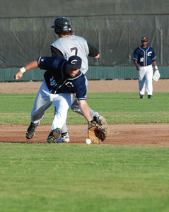 JosŽ Quezada/For the Times-Standard  Crabs second baseman #19 scoops up the ball before throwing to first for the out.