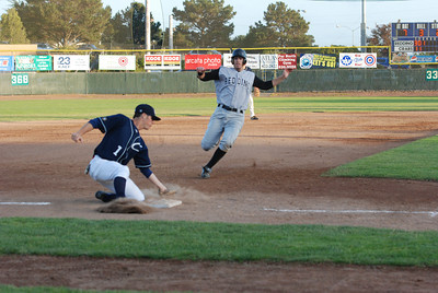 José Quezada/For the Times-Standard  #1 third baseman Del Grande smothers the ball before making the tag for an out.