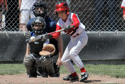 Josh Jackson/The Times-Standard  Mack's #8 bunts during Saturday's game in Cutten.