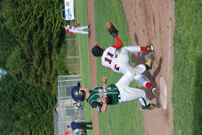 JosŽ Quezada/For the Times-Standard  RELL #28 beats the throw to first as McKinleyville #11 hauls the throw in.