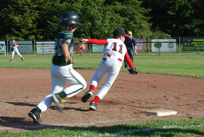 José Quezada/For the Times-Standard  RELL #28 is safe on first as ball goes past McKinleyville first baseman #11 on a throwing error.