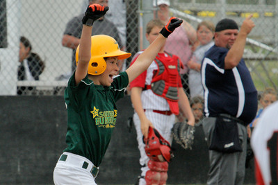 Josh Jackson/The Times-Standard  Southern Humboldt's Dylan Knostman celebrates a solo home run as he runs the bases during Saturday's game in McKinleyville.
