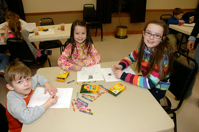 Autin Lovett(4), and Anaika(6) & Anissa(9) Kilinski color for the snowman contest. photo by Tony Bucca