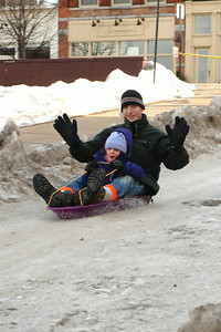Natalie and Jerry Arendt of Ballston kick up some snow as they go downhill. photo by Tony Bucca