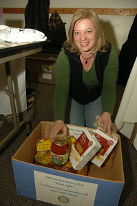 Cindy Pastore of the Ballston Spa Rotary looks over donations to the Food Pantry. photo by Tony Bucca