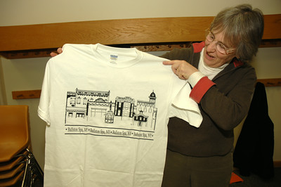 Rae Whitehead holds up a tee-shirt for Ballston Spa at the Farmer's Market info table. photo by Tony Bucca