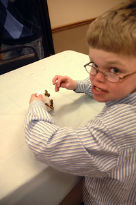 10 year old Devon Jude builds a marshmallow snowman. photo by Tony Bucca