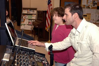 Krista Cook helps DJ Greg Frasier with a playlist. photo by Tony Bucca