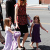 Amy Schnelter took part in Friday's funeral procession for John J. Consolati of Lee.  With her is her five-year-old daughter, Stefanie (right) and five-year-old Eliza Burrey.  Lee, 5/28/10 - Ian Grey