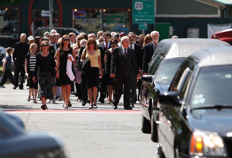 A funeral procession of roughly 100 people makes its way up Main Street in Lee on Friday.  The procession was held for John J. Consolati and consisted of family, former athletes that he coached over his 40 year career, friends, colleagues and former students.  Lee, 5/28/10 - Ian Grey