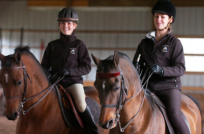 Equestrians Molly Kern, left, and Hannah Carr. Ed Burke 9/30/09