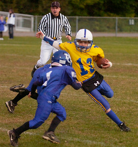 Saratoga's Jack Cairns runs the ball as North Colonie's Dominick Federici closes in. Ed Burke 10/17/09