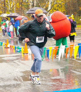 Tom Marcellus of Ballston Spa finishes the rain-soaked Great Pumpkin Challenge Saturday in Saratoga Spa State Park. Ed Burke 10/27/09