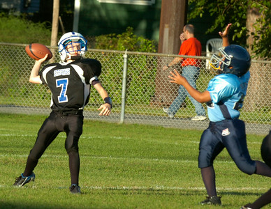 Saratoga Pop Warner player Max Kabanuk throws a pass during Saturday's game at East Side Rec against East Greenbush. Ed Burke 9/12/09