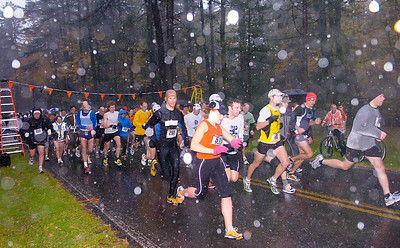 Runners leave the start of the Great Pumpkin Challenge Saturday at Saratoga Spa State Park. The 5K and 10K race raised money for Saratoga Bridges. Ed Burke 10/24/09
