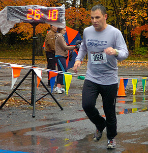 Jody Mostoller of Ballston Spa competes in Saturday's rain-soaked Great Pumpkin Challenge at Saratoga Spa State Park. Ed Burke 10/24/09