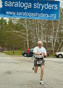 Bill Venner of Hartford finishes first overall in Saturday's St. Peter's Keys 10K race at Saratoga Spa State Park. Ed Burke 4/18/09