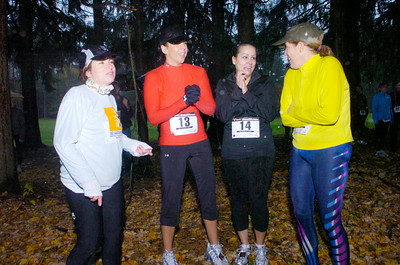 Runners try to stay dry before Saturday's Great Pumpkin Challenge at Saratoga Spa State Park. From left: Beth Gelber of Wilton, Toni Howard and Alyssa Conlin of Clifton Park and Maureen Roberts of Wilton. Ed Burke 10/24/09