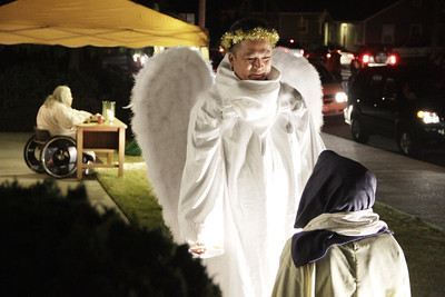 Shaun Walker/The Times-Standard  The angel Gabriel, aka Sacheo Tanuma, counsels Mary, aka Kesslyn Martin, at the First Covenant Church of Eureka's Live Nativity on Thursday night. The Nativity refers to accounts of the Dec. 25 birth of Jesus in Bethlehem to the virgin mother Mary about 2011 years ago. Eight live nativity scenes portraying the story of Christmas can be viewed tonight [FRIDAY] from 6 to 8 p.m. from a car while listening to a recorded narrative or on foot. To avoid traffic congestion the following route needs to be followed: from Buhne St., turn south onto K St., turn right onto Carson then right onto J St. The nativity is gift to the community from the church.