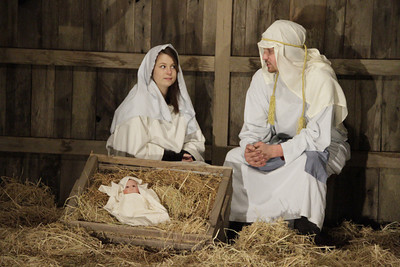 Shaun Walker/The Times-Standard  Mary and Joseph, aka Mary and Jared Kemp, sit with a baby Jesus doll at the First Covenant Church of Eureka's Live Nativity on Thursday night. The Nativity refers to accounts of the Dec. 25 birth of Jesus in Bethlehem to the virgin mother Mary about 2011 years ago. Eight live nativity scenes portraying the story of Christmas can be viewed tonight [FRIDAY] from 6 to 8 p.m. from a car while listening to a recorded narrative or on foot. To avoid traffic congestion the following route needs to be followed: from Buhne St., turn south onto K St., turn right onto Carson then right onto J St. The nativity is gift to the community from the church.