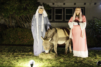 Shaun Walker/The Times-Standard  Joseph, aka Kenny Carswell, and his pregnant fiancé Mary, aka Heather Huber, rest with their donkey at the First Covenant Church of Eureka's Live Nativity on Thursday night. The Nativity refers to accounts of the Dec. 25 birth of Jesus in Bethlehem to the virgin mother Mary about 2011 years ago. Eight live nativity scenes portraying the story of Christmas can be viewed tonight [FRIDAY] from 6 to 8 p.m. from a car while listening to a recorded narrative or on foot. To avoid traffic congestion the following route needs to be followed: from Buhne St., turn south onto K St., turn right onto Carson then right onto J St. The nativity is gift to the community from the church.
