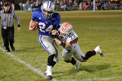 Josh Jackson/The Times-Standard  Fortuna's #24 carries the ball out of bounds as Eureka's #22 puts the pressure on during Friday's game in Fortuna.