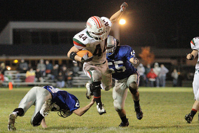 Josh Jackson/The Times-Standard  Eureka's #44 leaps Fortuna's #24 during Friday's game in Fortuna.